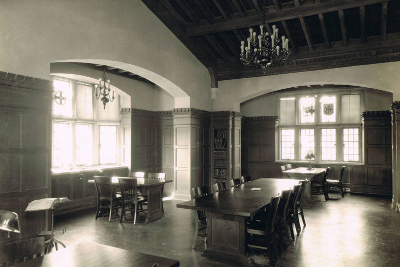 old library with long tables and chairs