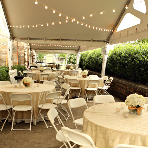 tent over patio with tables and chairs