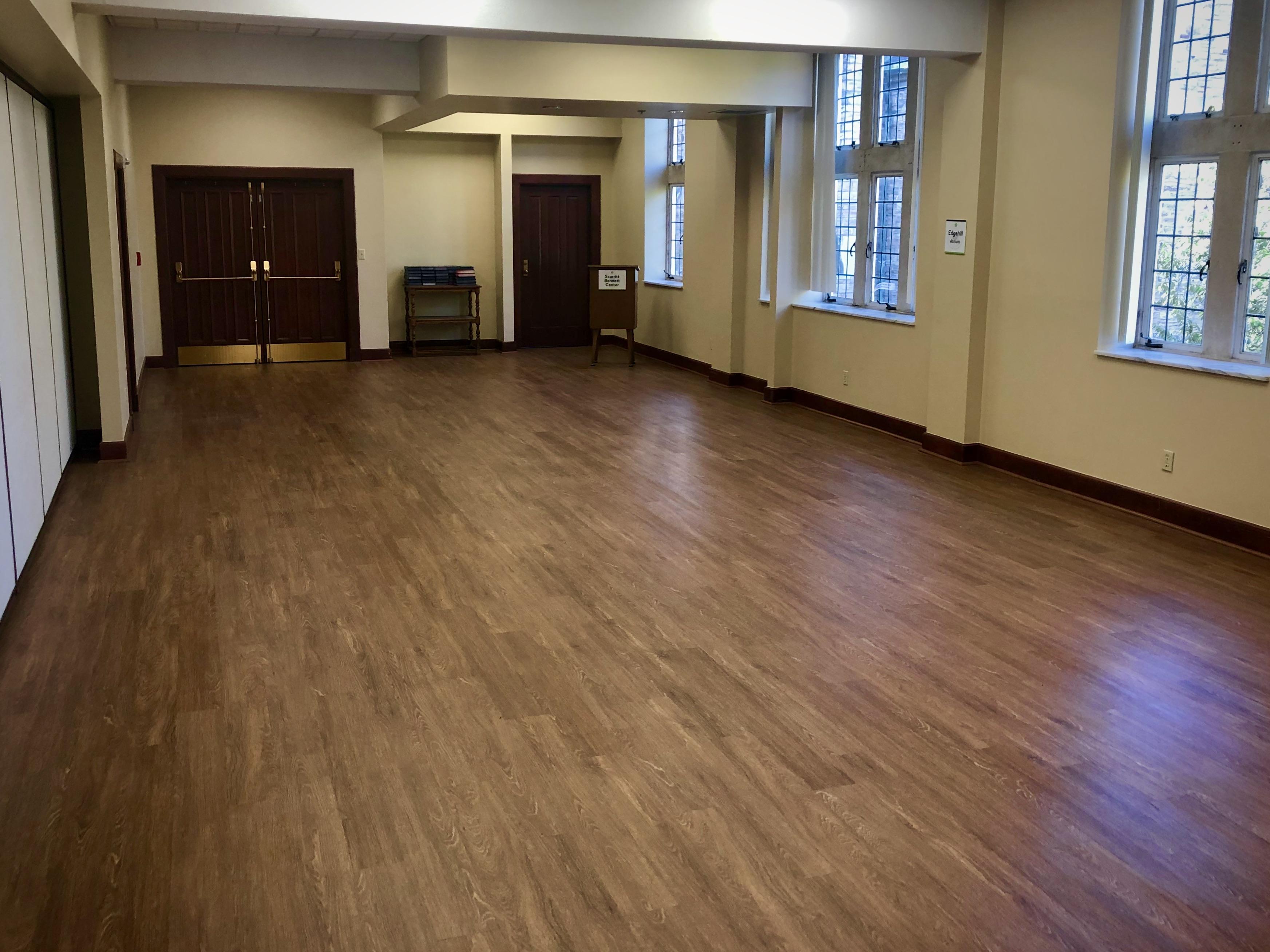 Large atrium with wood floors