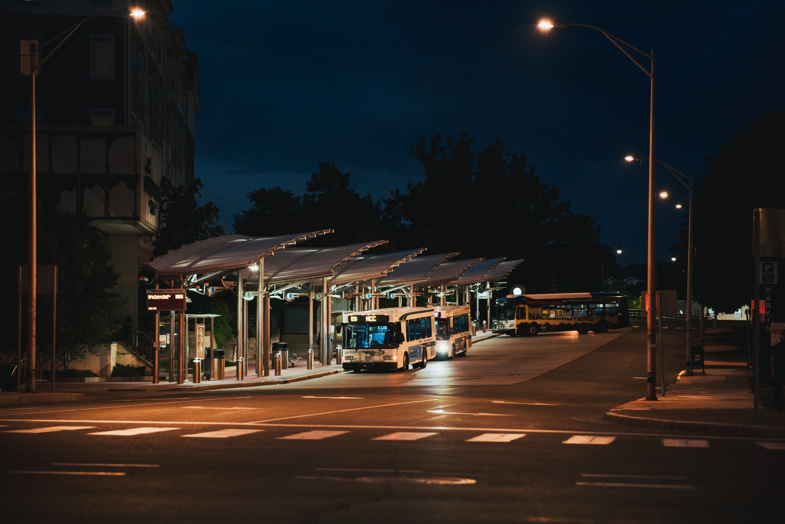 Photo of a bus station at night