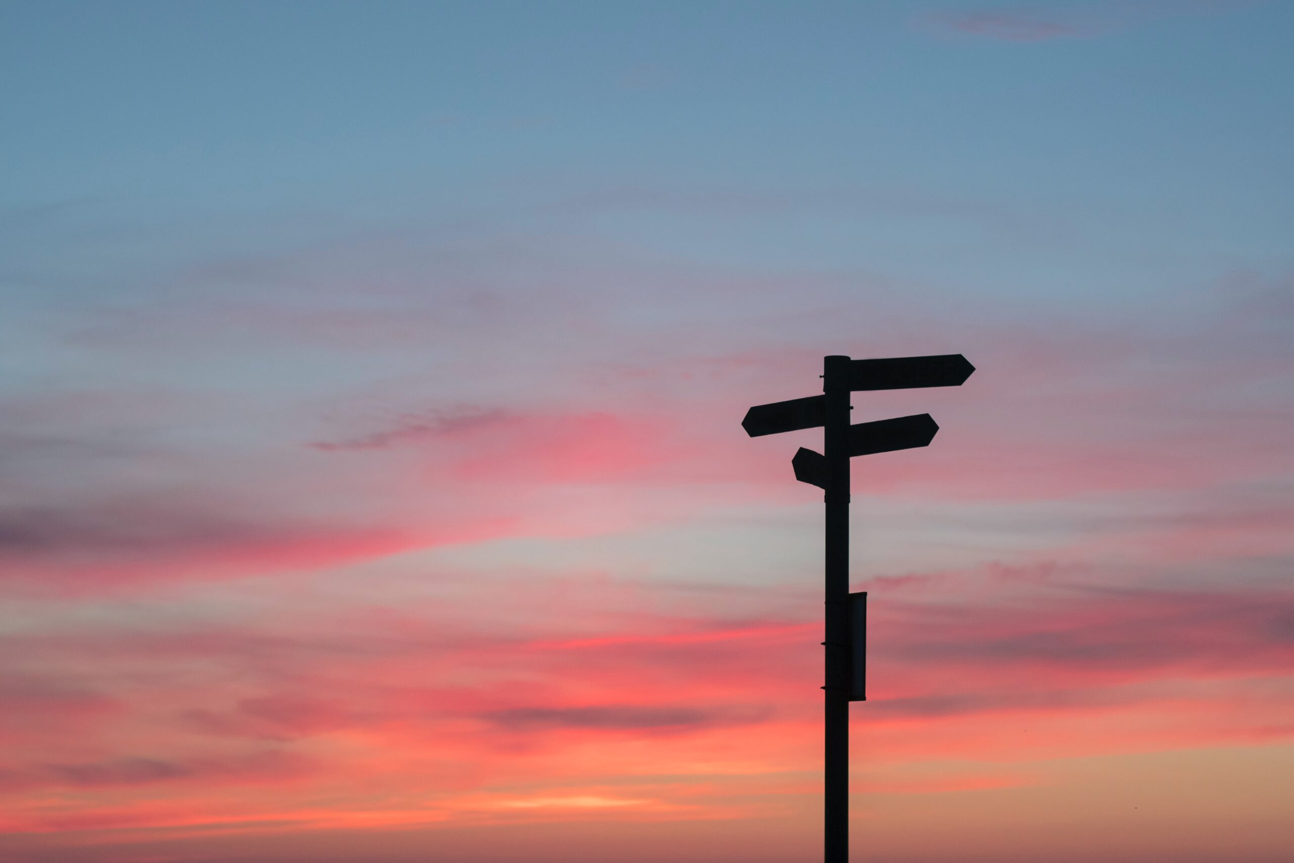 Crossroads sign at dusk